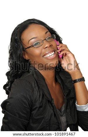 A lovely young black businesswoman with her pink cellular phone.  Isolated on a white background.