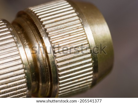 A macro shot of a brass hose connector.
