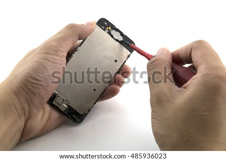 A man changing the home button of the mobile phone .