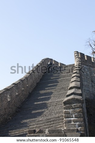 A Man Climbing The Great Wall Of China