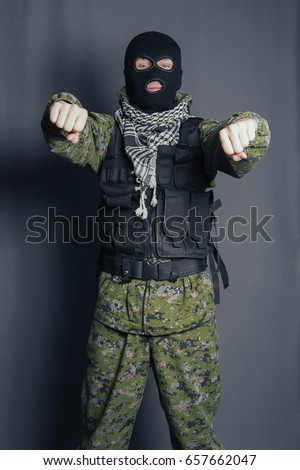 a man in camouflage and bullet proof vest with a balaclava on his head - Halloween Bullet Proof Vest
