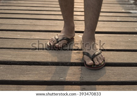A man walking on aged wooden floor