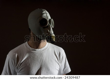 a man wearing a gas mask environment danger concept image