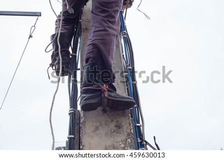 A man who working on a electricity post