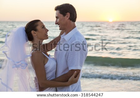 A married couple, bride and groom, together sunset sunrise on a beautiful tropical beach