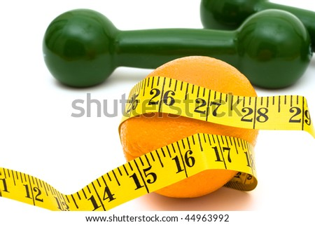 A measuring tape wrapped around an orange with hand weights