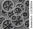A Mechanical Background with Gears and Cogs - stock photo
