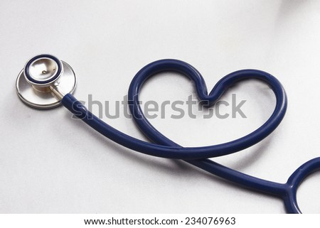 A medical stethoscope shaping a heart