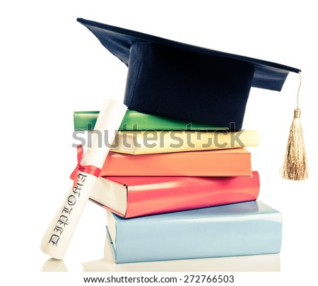 A mortarboard and graduation scroll, tied with red ribbon, on a stack of books