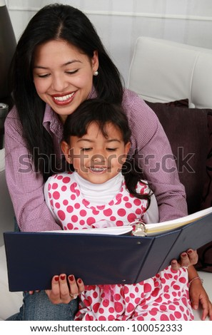 A mother and daughter reading book stories