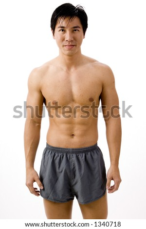 A muscular asian man in running shorts