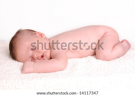 A naked baby taking a nap