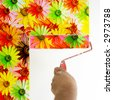 a paint roller with multi colored daisy flowers - stock photo