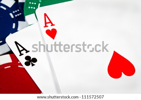 A pair of aces over poker chips