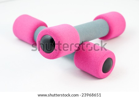 A pair of  pink hand weights on a white background