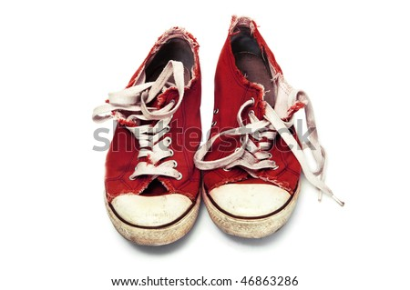 a pair of red sneakers isolated on a white background