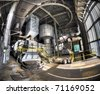 A panorama of the interior of an abandoned power plant. Light slides down the floor creating a moody image. - stock photo