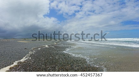 A panorama view of Carrowniskey Strand beach on the West coast of the Atlantic highway in Summer with stranded Jelly fish on the shore after a clearing Summer storm, near Louisburgh, Co. Mayo, Ireland