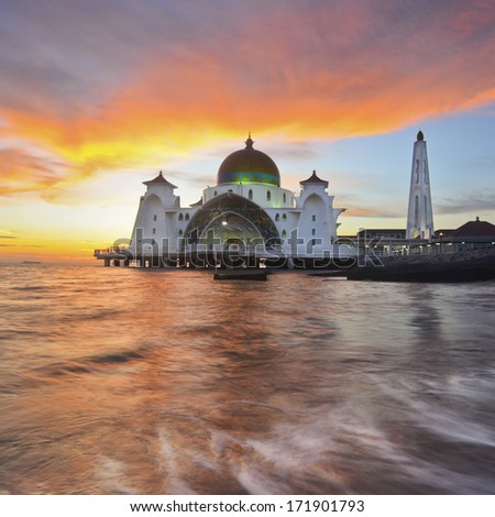 a panoramic view of floating public mosque during awesome sunset