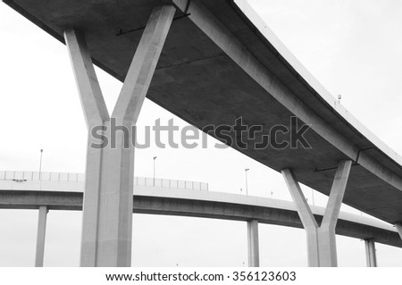 a part of elevated expressway in black and white
