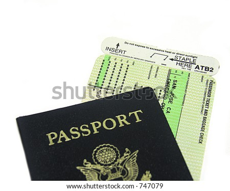 A photo of a passport and airplane ticket