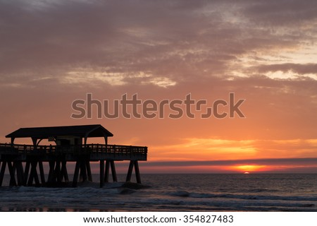 A photograph of a sunrise at Tybee Island in Savannah. Tybee Island is an island and city in Chatham County, Georgia.