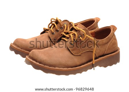 A picture of a pair of male shoes over white background