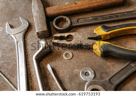 types of antique hammers. a picture of old, used, dirty tool lying on the metal table. many types antique hammers