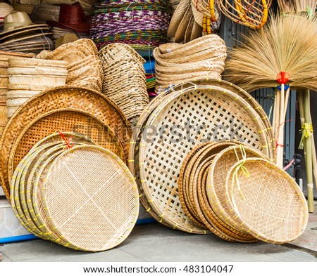 A pile of hand made wicker baskets in  a shop