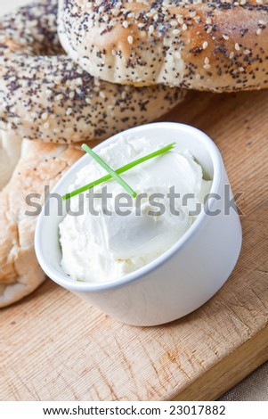 A pile of 4 mixed bagels with cream cheese