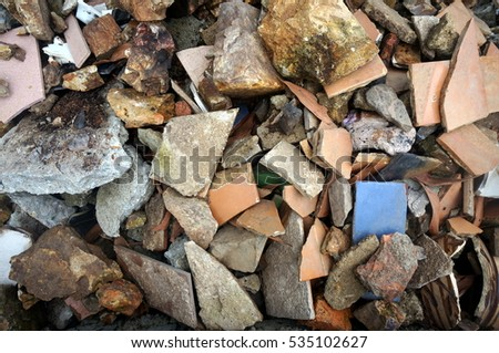 a pile of stones and broken tiles