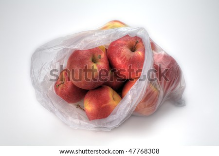 A Plastic Bag of Gala Apples Isolated on White