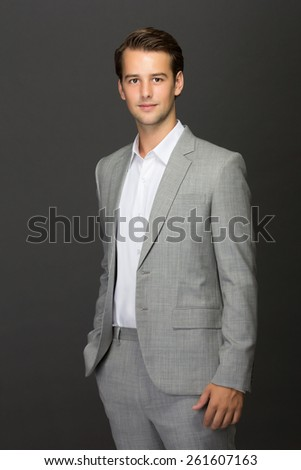 a portrait of a charming young man in suit looks good