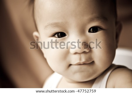 A portrait of a cute asian baby