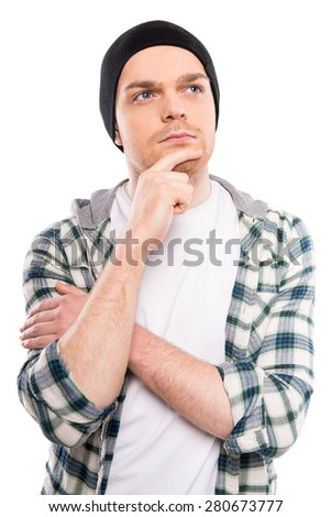 A portrait of a young handsome man lost in his thoughts. White background.