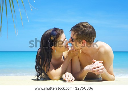 a portrait of attractive couple having chat on the beach