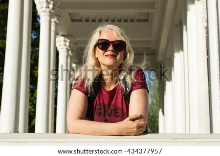 Clam of blond teen holding sunglasses hot