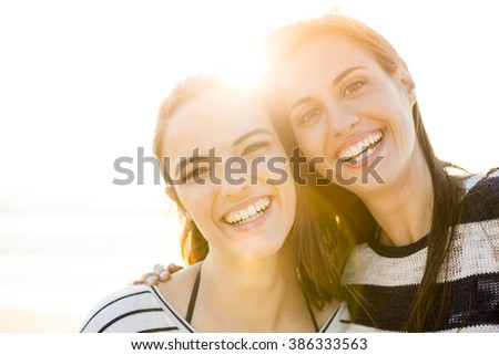 A portrait of best friends laughing