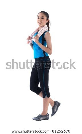 A pretty woman walking for exercise