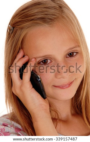 A pretty young girl with blond hair standing in closeup for white 