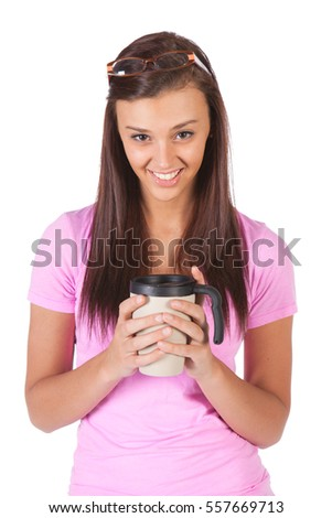 A pretty young woman drinking a cup of coffee