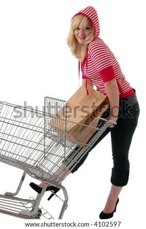 A pretty young woman in red grocery shopping