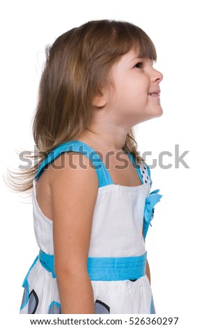 A profile portrait of a cute little girl on the white background