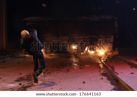 A protester throws stones at police. Kyiv, Ukraine, January 19, 2014