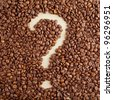 A question-mark symbol made from coffee crops on handmade paper - stock photo