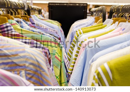 A rack shirts at a market