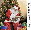 A real Santa Claus portrait checking his list - stock photo