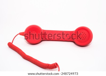 A red telephone receiver on white background.