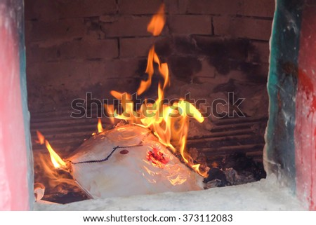 A ritual to burn the golden paper to the ancestor to pay respect and celebrate the new year