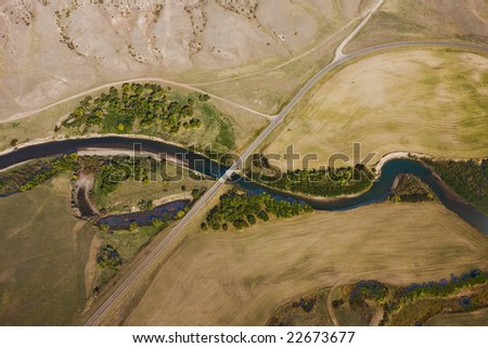 A river and highway with bridge from an aerial view